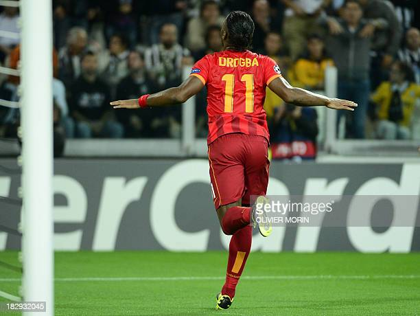 Galatasaray's forward Didier Drogba celebrates after scoring during the group B Champions League football match Juventus vs Galatasaray on October 2...