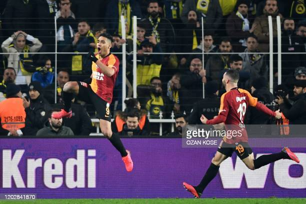 Galatasaray's forward Radamel Falcao celebrates with his teammates after scoring a goal during the Turkish Super league football match between...