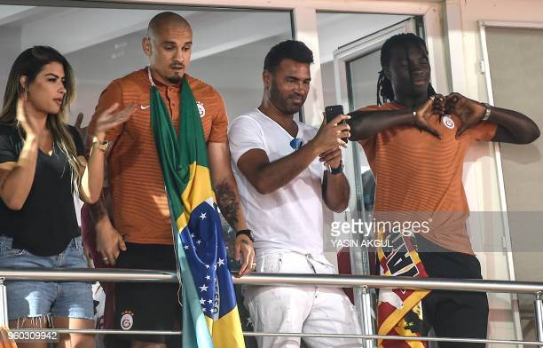Galatasaray's French forward Bafetimbi Gomis greets supporters at Florya Metin Oktay facilities in Istanbul on May 19, 2018 after Galatasaray won the...