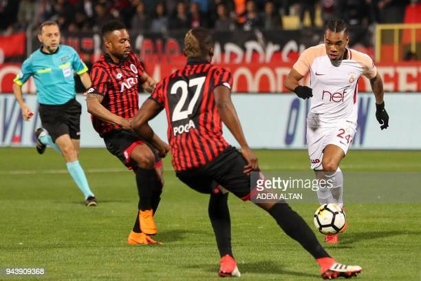 Galatasaray's Garry Mendes Rodrigues vies with Genclerbirligi's Florentin Pogba during the Turkish Super Lig football match between Genclerbirligi...