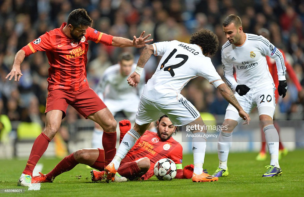 Galatasaray's Gokhan Zan (L) vies with Real Madrid's Marcelo during the UEFA Champions League football match between Real Madrid vs Galatasaray at the Santiago Bernabeu Stadium on November 27, 2013 in Madrid.