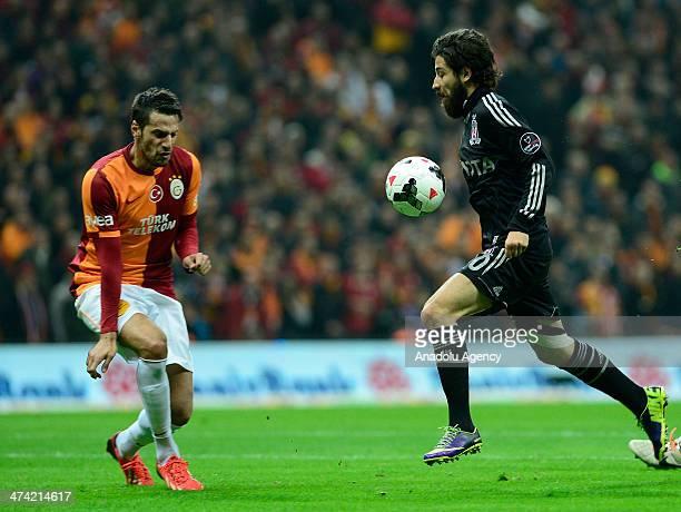 Galatasaray's Hakan Balta struggles with his competitor Olcay Sahan of Besiktas during the Turkish Spor Toto Super League soccer match between...