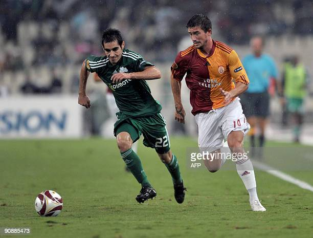 Galatasaray's Harry Kewell fights for the ball with Panathinaikos's Sergios Marinos during their Europa Leagua football games at the Athens Olympic...