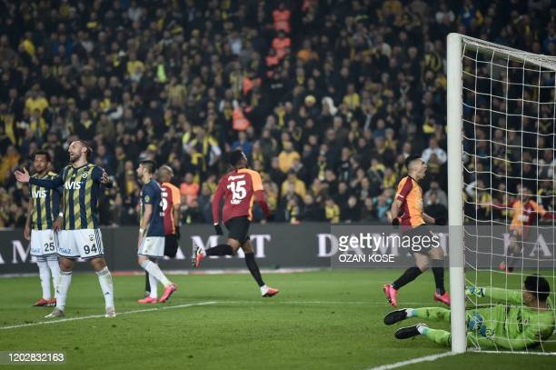 Galatasaray's Henry Onyekuru celebrates with his teammates after scoring a goal during the Turkish Super league football match between Fenerbahce and...