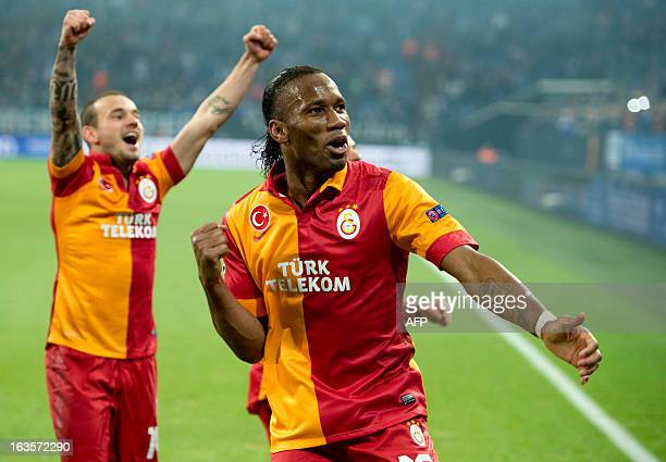 Galatasaray's Ivorian forward Didier Drogba and Galatasaray's Dutch midfielder Wesley Sneijder celebrates at the end during the UEFA Champions League...