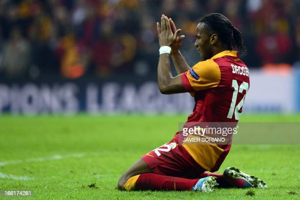 Galatasaray's Ivorian forward Didier Drogba gestures on April 9 2013 during a UEFA Champions League quarterfinal second leg football match against...