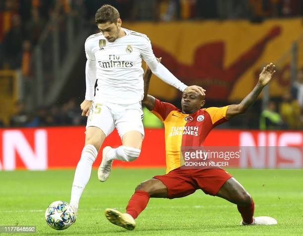 Galatasaray's Ivorian midfielder Jean Michael Seri tackles Real Madrid's Uruguayan midfielder Federico Valverde during the UEFA Champions League...