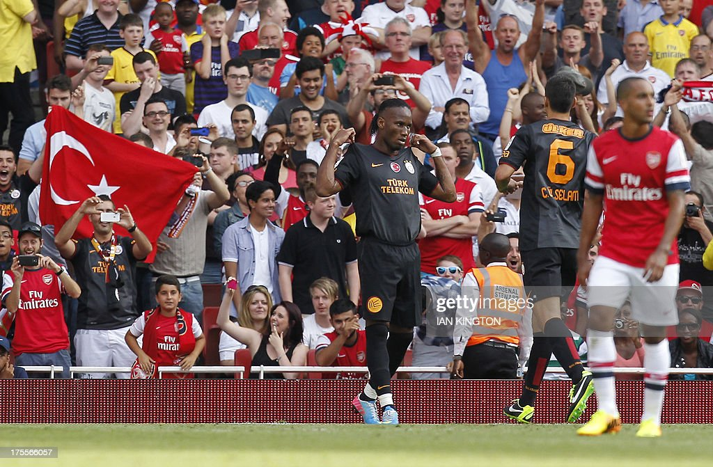 Galatasaray's Ivorian striker Didier Drogba (C) celebrates scoring a penalty during the pre-season friendly football match between Arsenal and Galatasaray at The Emirates Stadium in north London on August 4, 2013, the game is one of four matches played over two days for the Emirates Cup.