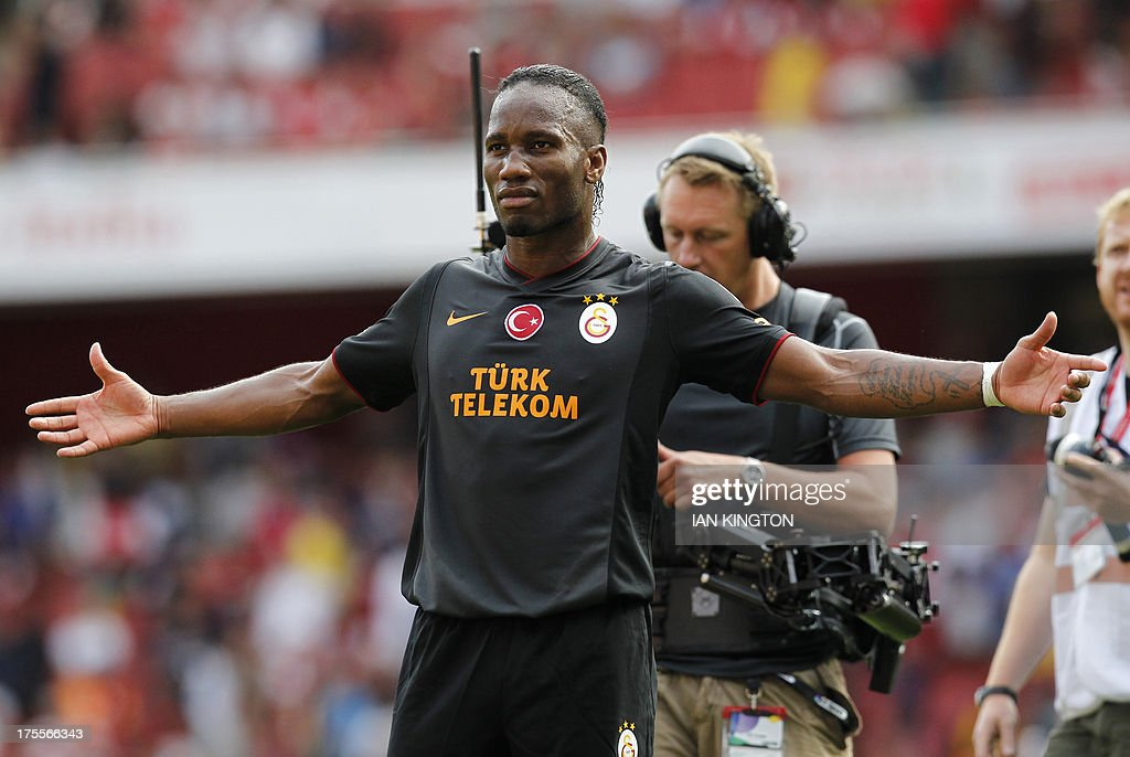 Galatasaray's Ivorian striker Didier Drogba reacts at the final whistle after scoring his side's two goals in the pre-season friendly football match between Arsenal and Galatasaray at The Emirates Stadium in north London on August 4, 2013, the game is one of four matches played over two days for the Emirates Cup. Galatasaray won the game 2-1, and the trophy.