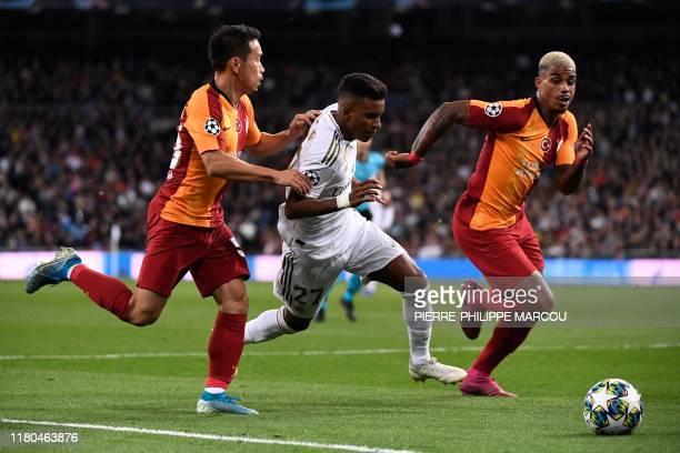 Galatasaray's Japanese defender Yuto Nagatomo and Galatasaray's Gabonese midfielder Mario Lemina challenge Real Madrid's Brazilian forward Rodrygo...