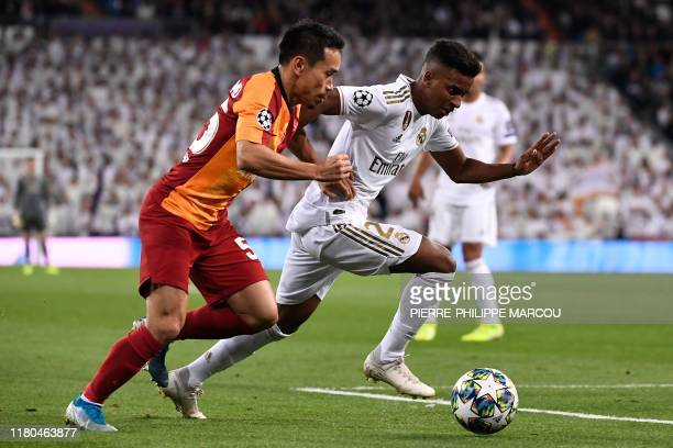 Galatasaray's Japanese defender Yuto Nagatomo challenges Real Madrid's Brazilian forward Rodrygo during the UEFA Champions League Group A football...