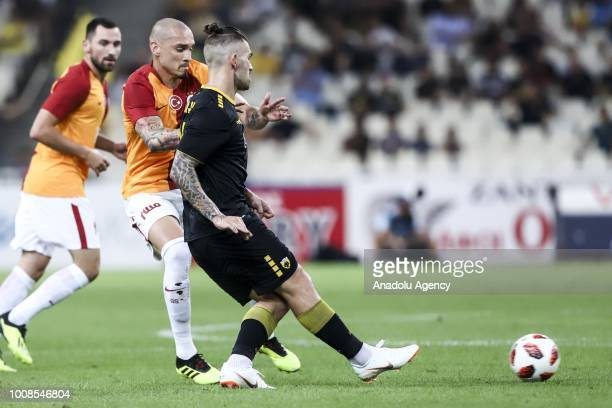 Galatasaray's Maicon and Marko Livaja of AEK Athens during friendly football game between AEK Athens and Galatasaray in OAKA Stadium in Athens on...
