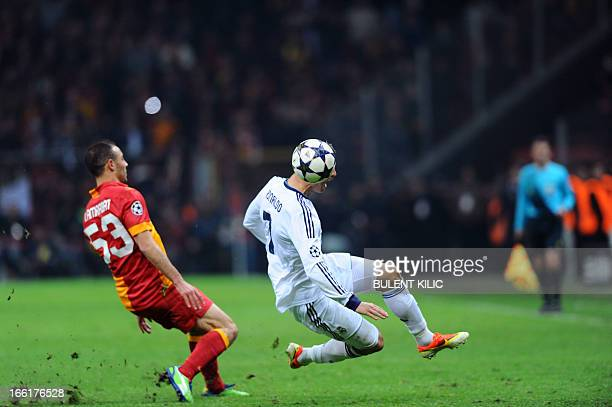 Galatasaray's Moroccan midfielder Nordin Amrabat vies with Real Madrid's Portuguese forward Cristiano Ronaldo during the UEFA Champions League...