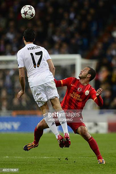 Galatasaray's Moroccan midfielder Nordin Amrabat vies with Real Madrid's defender Alvaro Arbeloa during the UEFA Champions League football match Real...