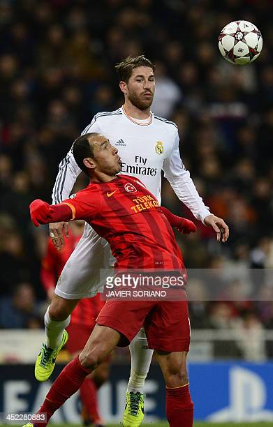 Galatasaray's Moroccan midfielder Nordin Amrabat vies with Real Madrid's defender Sergio Ramos during the UEFA Champions League football match Real...