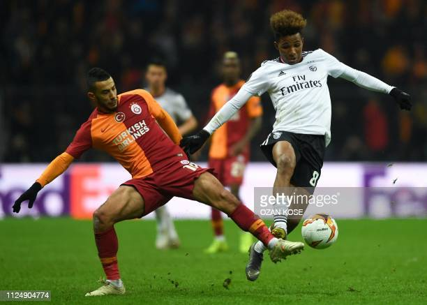 Galatasaray's Moroccan midfielder Younes Belhanda fights for the ball with Benfica's Portuguese midfielder Gedson Fernandes during the UEFA Europa...