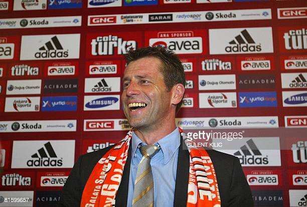 Galatasaray's new coach Michael Skibbe smiles as he delivers a speech during a signing ceremony on June 17 2008 in Istanbul Skibbe has signed a...