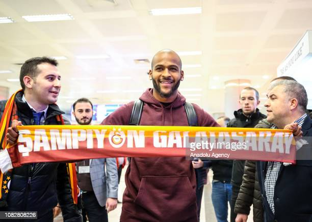 Galatasaray's new transfer Marcos Do Nascimento Teixeira poses with a Galatasaray's scarf as he arrives in Istanbul Turkey on January 15 2019