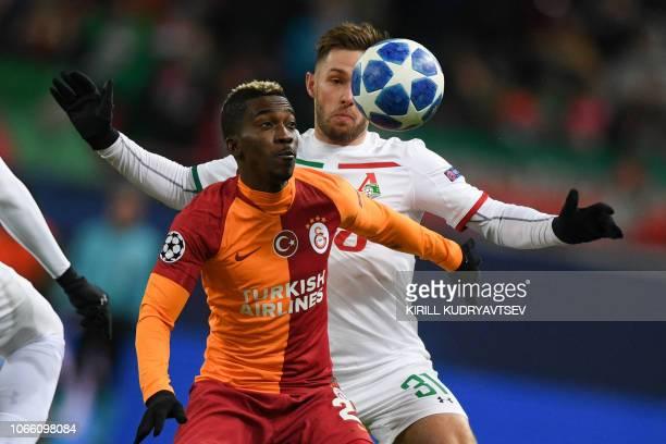 Galatasaray's Nigerian forward Henry Onyekuru and Lokomotiv Moscow's Polish midfielder Maciej Rybus vie for the ball during the UEFA Champions League...