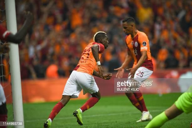Galatasaray's Nigerian forward Henry Onyekuru celebrates his goal against Medipol Basaksehir during the Turkish Super Lig match between Galatasaray...