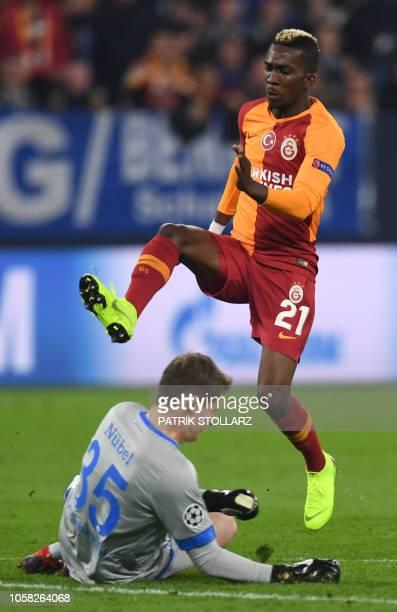 Galatasaray's Nigerian forward Henry Onyekuru fails to score past Schalke's German goalkeeper Alexander Nuebel during the UEFA Champions League group...