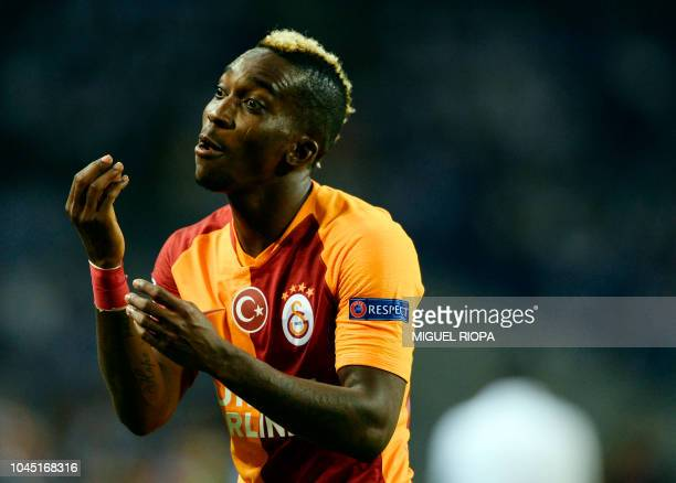 Galatasaray's Nigerian forward Henry Onyekuru gestures during the UEFA Champions League group D football match between FC Porto and Galatasaray SK at...