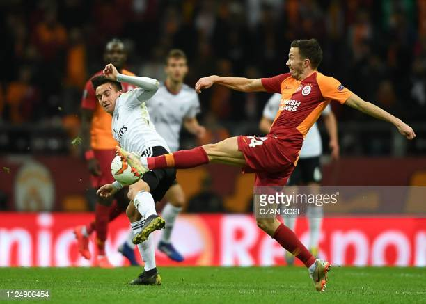 TOPSHOT Galatasaray's Norwegian defender Martin Linnes fights for the ball with Benfica's Argentinian midfielder Franco Cervi during the UEFA Europa...
