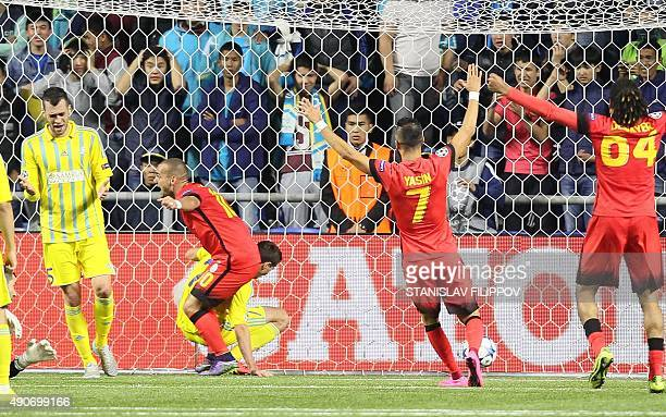 Galatasaray's players celebrate a goal during the UEFA Champions League group C football match between FC Astana and Galatasaray AS at the Astana...