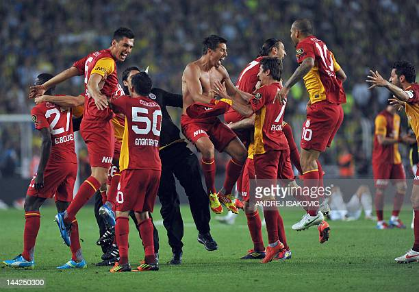 Galatasaray's players celebrate after they won the Turkish Super League playoff final football match Fenerbahce vs Galatasaray and the turkish...
