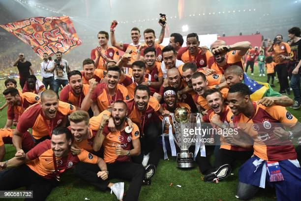 Galatasaray's players celebrate their 20172018 Turkish league champion title during a trophy cerenomy a day after the Turkish Spor Toto Super league...