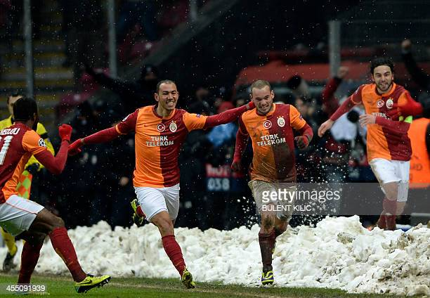 Galatasaray's players celebrate winning against Juventus during the UEFA Champions League group B football match on December 11 at Turk Telekom Arena...