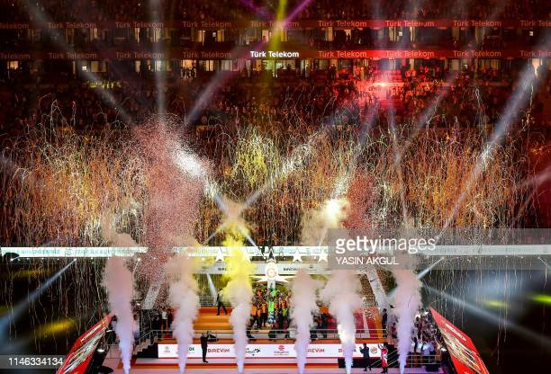 Galatasaray's players hold the trophy during a victory ceremony of Turkish Super League 2018-2019 season on May 25, 2019 at the Turk Telekom Arena...