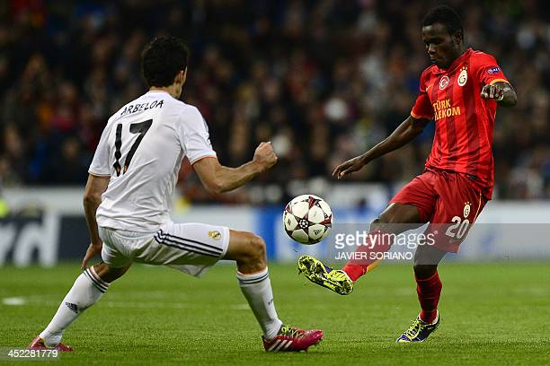 Galatasaray's Portuguese midfielder Bruma vies with Real Madrid's defender Alvaro Arbeloa during the UEFA Champions League football match Real Madrid...