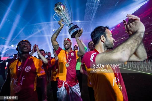 Galatasaray's Ryan Donk holds the trophy during the victory ceremony of Turkish Super League 2018-2019 season on May 25, 2019 at the Turk Telekom...