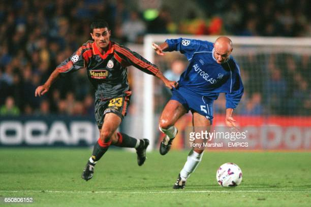 LR Galatasaray's Sas Hasan attempts to tackle Chelsea's Frank Leboeuf