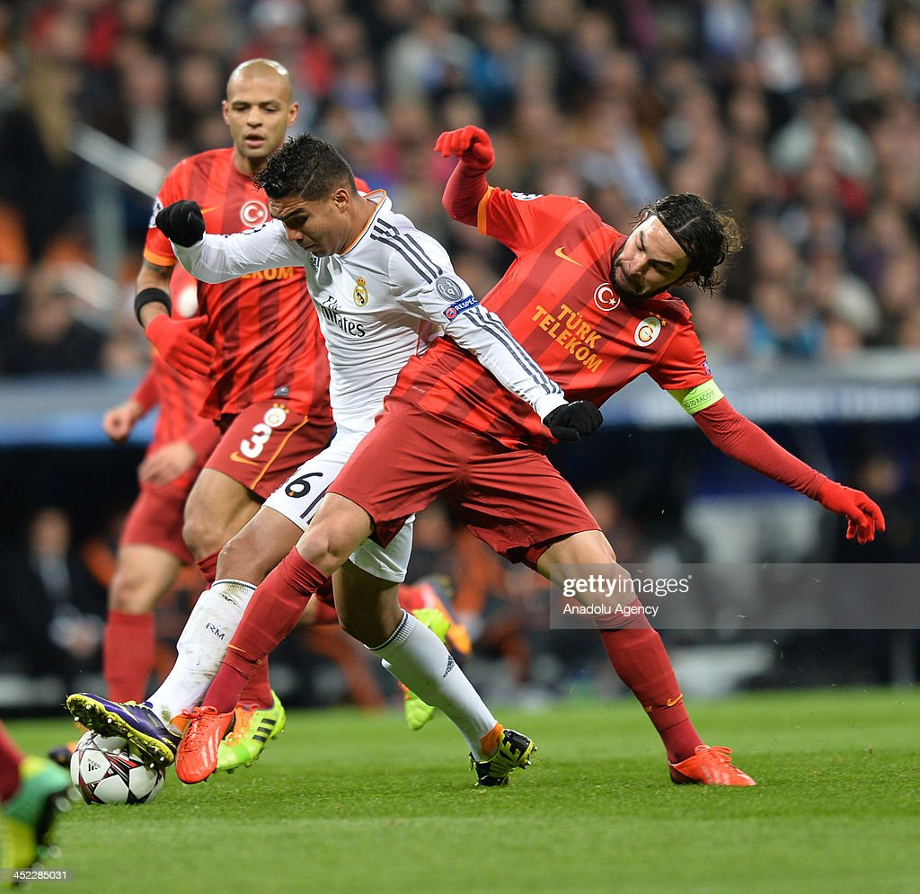 Galatasaray's Selcuk Inan (R) vies for the ball during the UEFA Champions League football match between Real Madrid vs Galatasaray at the Santiago Bernabeu Stadium on November 27, 2013 in Madrid.