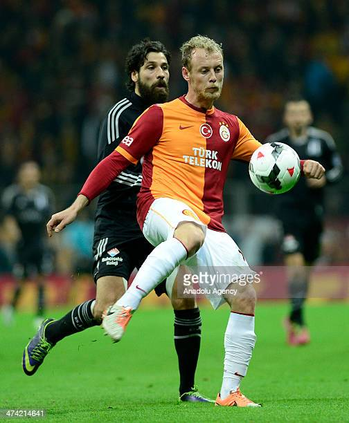 Galatasaray's Semih Kaya struggles with his competitor Olcay Sahan of Besiktas during the Turkish Spor Toto Super League soccer match between...