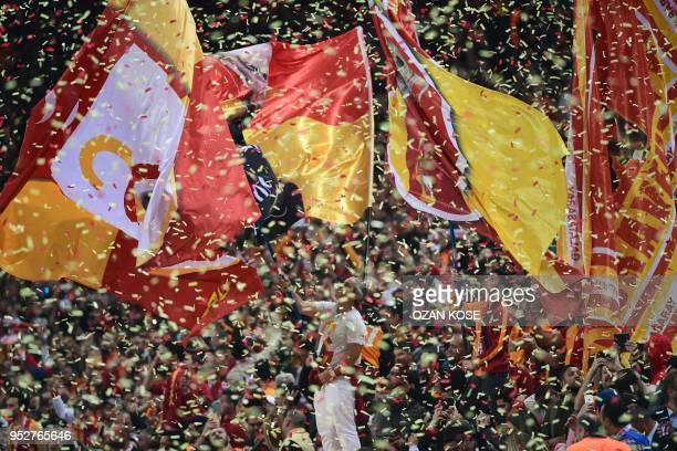 Galatasaray's supporters celebrate after winning the Turkish Spor Toto Super league football match between Galataray and Besiktas on April 29, 2018...