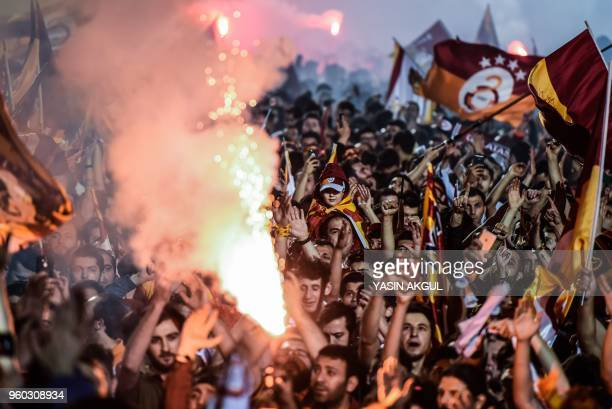 Galatasaray's supporters celebrate their 2017-2018 champion title at Florya Metin Oktay facilities in Istanbul on May 19, 2018 after the Turkish Spor...