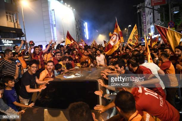 Galatasaray's supporters celebrate their 2017-2018 champion title in Istanbul on May 19 after the Turkish Spor Toto Super league football match...