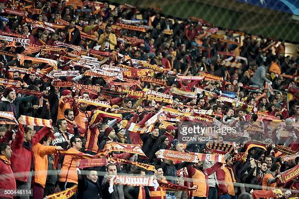 Galatasaray's supporters hold scarves during the UEFA Champions League Group C football match between Galatasaray AS and FC Astana at the Turk...