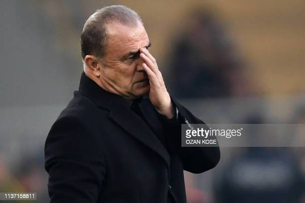 Galatasaray's Turkish coach Fatih Terim reacts during the Turkish Super league football match between Fenerbahce and Galatasaray on April 14 2019 at...