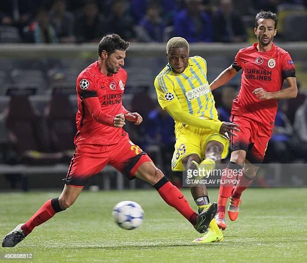 Galatasaray's Turkish defender Hakan Balta and Galatasaray's Turkish midfielder Bilal Kisa vie for the ball with Astana's Congolese forward Junior...