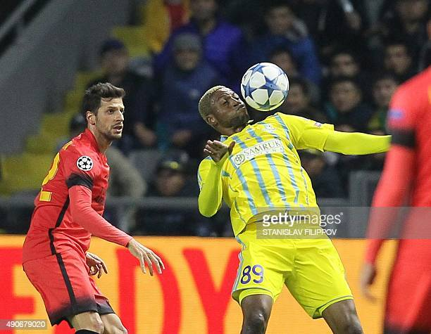 Galatasaray's Turkish defender Hakan Balta vies with Astana's Congolese forward Junior Kabananga during the UEFA Champions League group C football...