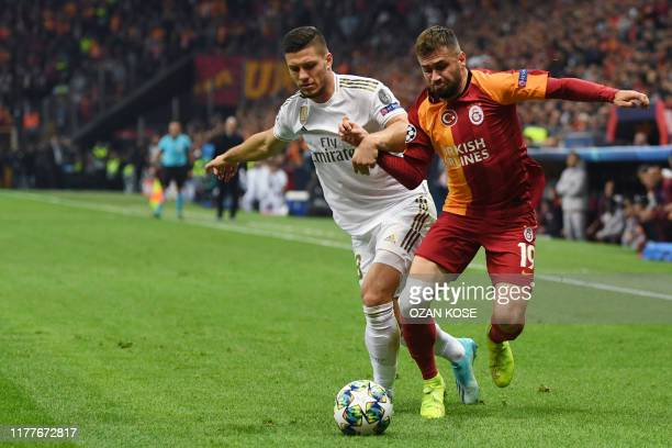 Galatasaray's Turkish defender Omer Bayram vies for the ball with Real Madrid's Serbian forward Luka Jovic during the UEFA Champions League group A...