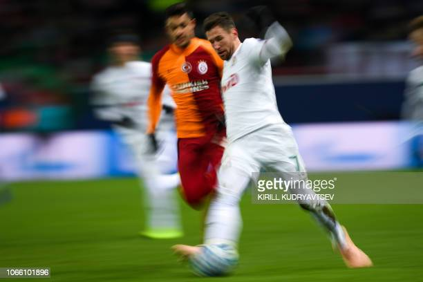 Galatasaray's Turkish defender Ozan Kabak and Lokomotiv Moscow's Polish midfielder Grzegorz Krychowiak vie for the ball during the UEFA Champions...