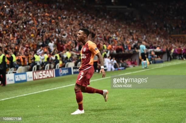 Galatasaray's Turkish forward Eren Derdiyok scores a goal during the UEFA champions league group D football match between Galatasaray and Lokomotiv...