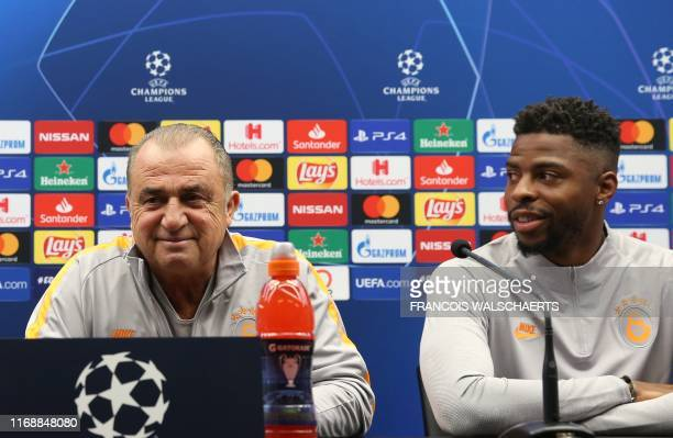 Galatasaray's Turkish head coach Fatih Terim and Dutch defender Ryan Donk give a press conference on September 17 2019 at the Jan Breydel stadium in...