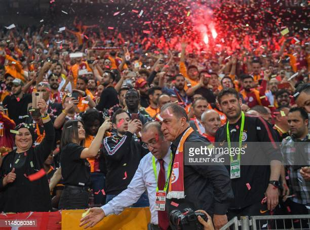 Galatasaray's Turkish head coach Fatih Terim celebrates his Turkish championship title after winning the Turkish Super Lig football match between...