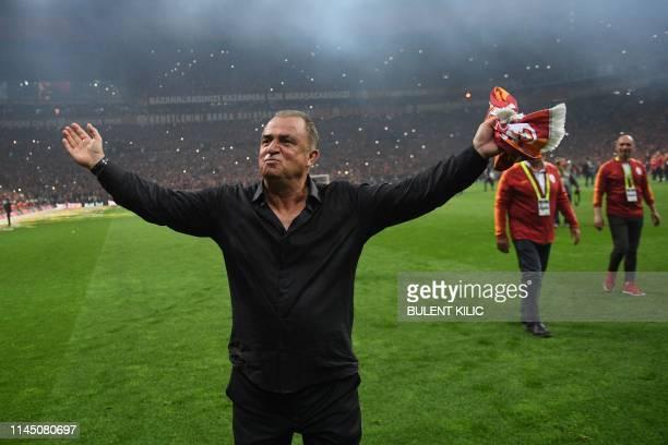 Galatasaray's Turkish head coach Fatih Terim celebrates his Turkish championship title after winning the Turkish Super Lig football match between...